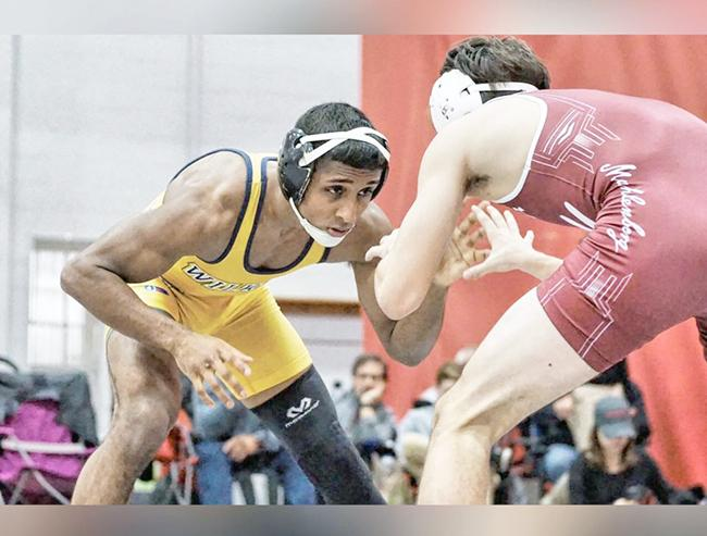 Chander wrestles an opponent from a recent match.