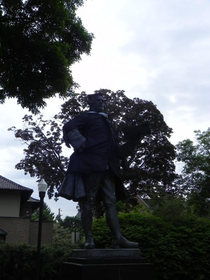 As a part of the commencement festivities, the statue of John Wilkes on the center of campus was dressed up in formal academic graduation attire.