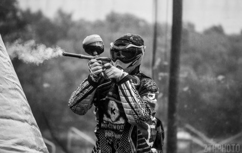 Players in paintball gear up in long sleeved shirts and long pants to protect their skin from the paintballs whizzing at them. They also wear pads at the competitive level because they slide on the ground often.