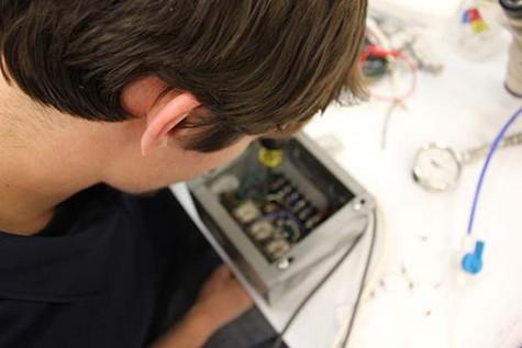 Dan Lykens at work during his internship with Entrepix in Mesa, Ariz.