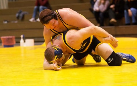 Wilkes Colonel William Fletcher (left) battles Ithaca's Shane Bartrum in the 285-weight class. Fletcher won the match in overtime.