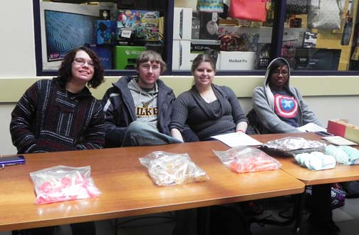 Members of the 'History Club' work their bake sale during club members to raise money. From left to right, Rachel Rakowski, Andrew Paski, Ashley Rash, and Melissa Thorne.