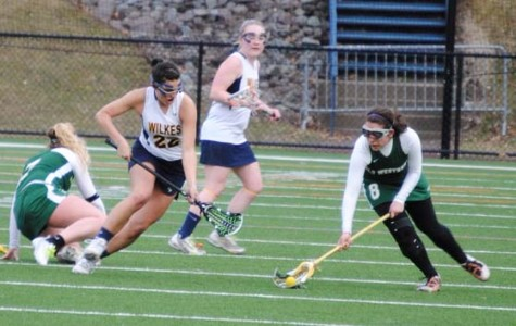 Senior midfielder Gabby Ford, #22, above, has been one of the leading scorers for the Lady Colonels' undefeated lacrosse team.