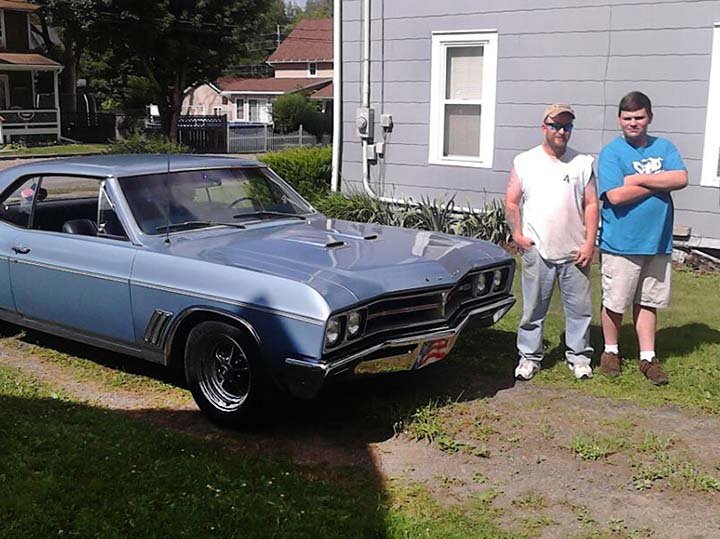 Zach+Benedict%2C+right%2C+stands+alongside+his+father+and+his+grandfather%27s+1967+Buick.