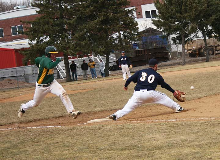 Sophomore first baseman Bobby O'Keefe reaches for the ball.