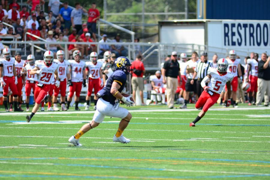 Pictured below is sophomore William Deemer  #6 returning a kick.
