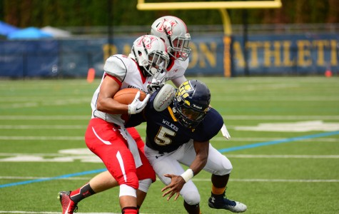 Pictured above is senior All-American  Omar Richardson #5 tackeling  a Muhlenberg player.