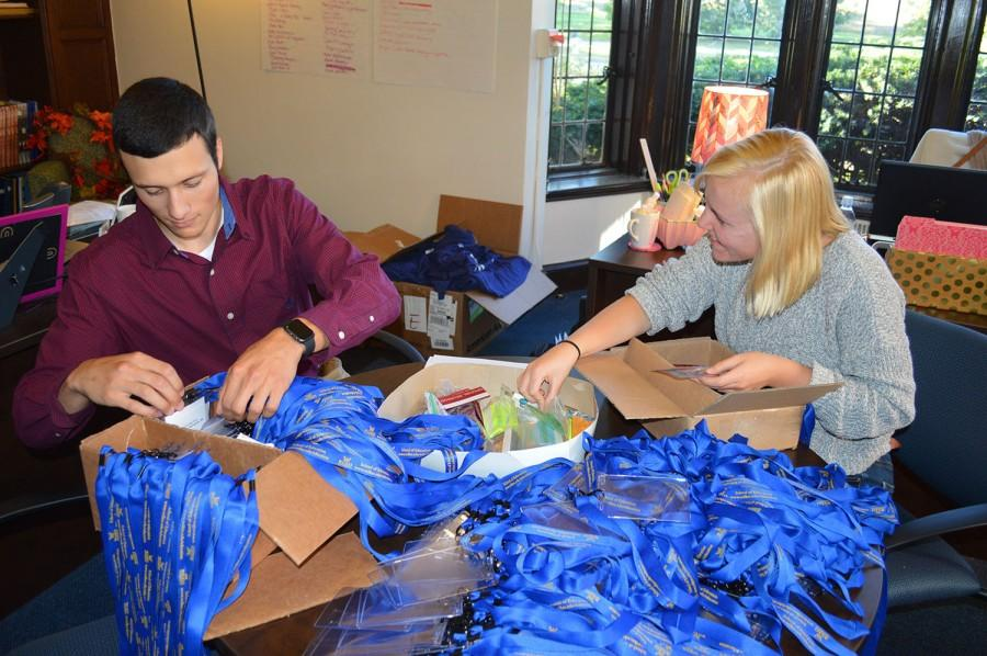 """At left: Anthony Fanucci and Makia Stocker prepare for homecoming festivities in the Alumni office.  """"Family of Colonels"""" is the theme for Wilkes Homecoming 2015. It will take place Friday, Oct. 2 through Sunday, Oct. 4, with various activities thoughout the weekend."""