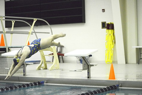 A member of the Wilkes swim team perfects her start in preparation for meets.