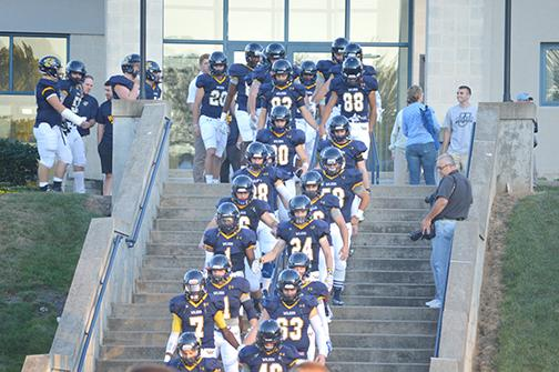 Colonels march down the stairs before last Friday's game.