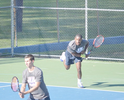 Member of men's tennis team recovers from serve at last week's match.