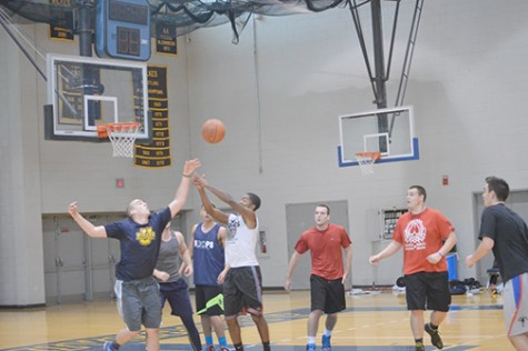Members of the men's basketball team compete hard for a rebound at a recent practice for their upcoming season right.