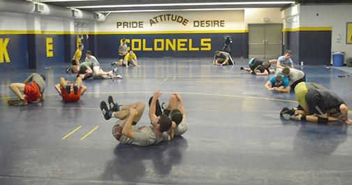 Wrestlers practice their top and bottom techniques during an off-season practice this past week.