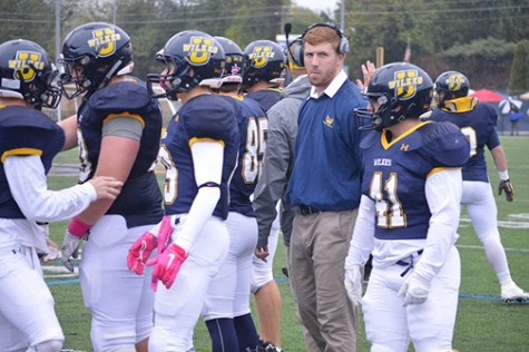 Hartman shares a moment with his team during a timeout the Homecoming  game against Widener.