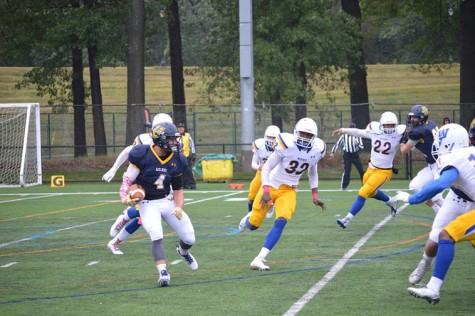 Wide Receiver Brett Ribellino runs the ball against a strong pride defense.