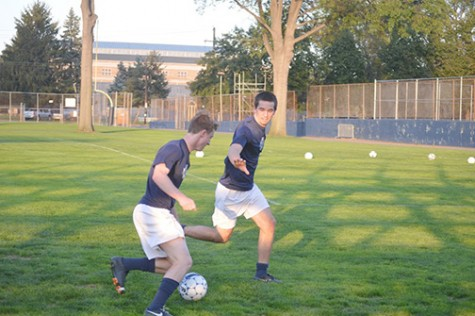 Men's soccer members perfect drills in pairs at a recent practice.
