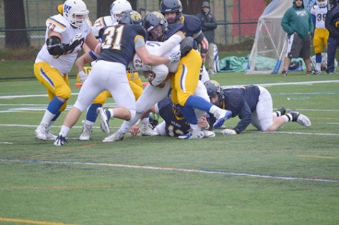 Junior Tanner Tengel makes a tackle during homecoming game against Widener.