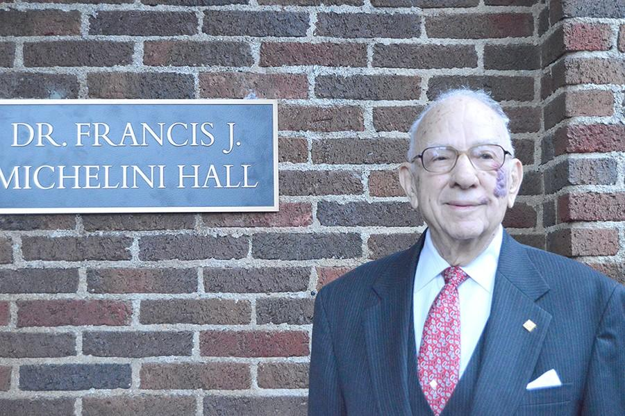 Dr. Francis Michelini stands infront of the newly renamed Michelini Hall after the dedication ceremony.