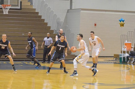 Freshman guard Clay Basalyga gets ready to set up  a teammate at this past Tuesday night's game.