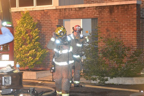 Firefighters leaving Bedford Hall after checking the inside of the building.