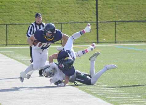 Wide receiver Aaron Coyne catches the ball on the sideline against Stevenson this past Saturday.