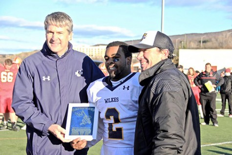Powell alongside President Leahy and head coach Trey Brown accepting the MVP award after the victorious win against King's this past Saturday.