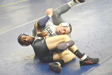 Michael Fleck practices a takedown with Pankil Chander at a recent practice this past week.