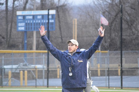 Curtis Jaques signaling to his players on the field  at a recent practice.