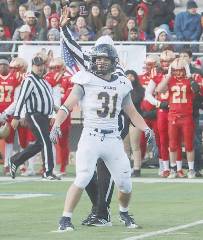 Tanner Stengel looks to the sidelines to receive the play call at the Wilkes/King's game.