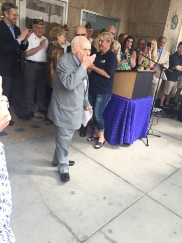 Albert Boscov blows kisses to his employees as he leaves his newly revamped department store.