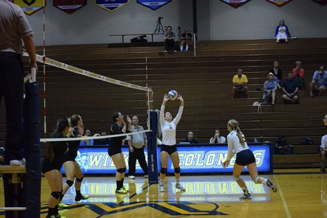 #2 junior Alexis Morgan sets the ball up for #16 freshman Alex Ferrier.