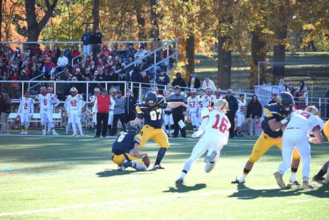 #97 Mike Hauck kicks an extra point held by #6 William Deemer.