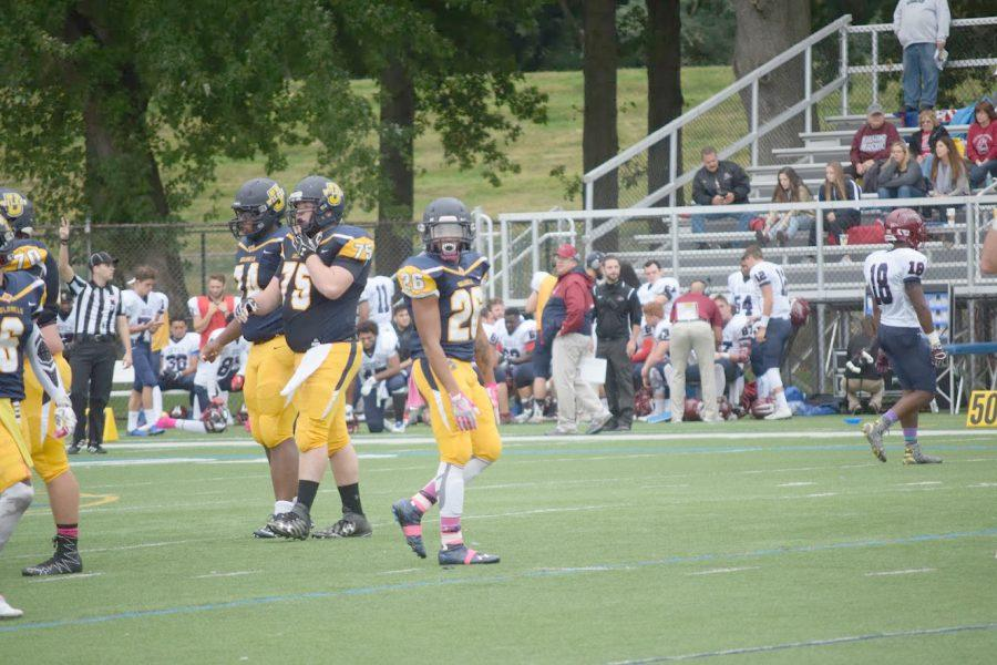 Wilkes #26 Devon Fink and #75 Anthony Marcincavage look to the sideline.