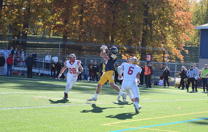 #87 Garrett Armstrong hauls in a Jose Tabora pass for a Colonel touchdown.