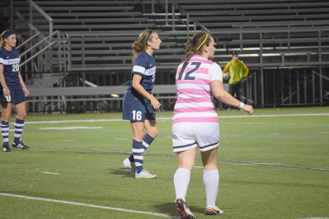 #18 junior defensive player Julia Tyler points out a player attacking.