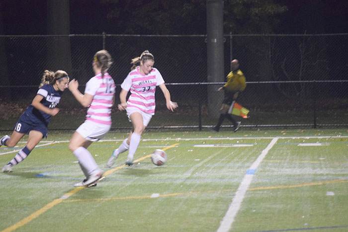 #22 Shelby Trumbo clears the ball upfield.