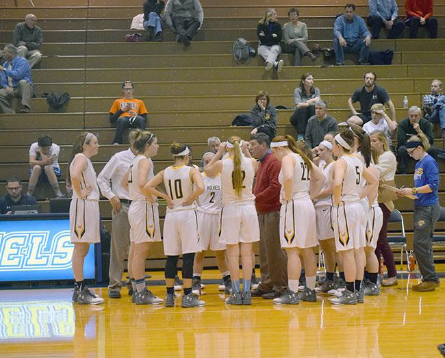 Women%27s+basketball+huddles+during+a+timeout+against+Misericordia.