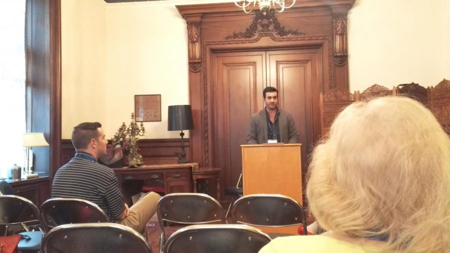 """Dr. Sean Kelly, one of the faculty advisors for the Manuscript Society, read an autumnal poem called """"Fall"""" by Dennis Tucker, a former writer at Wilkes University."""
