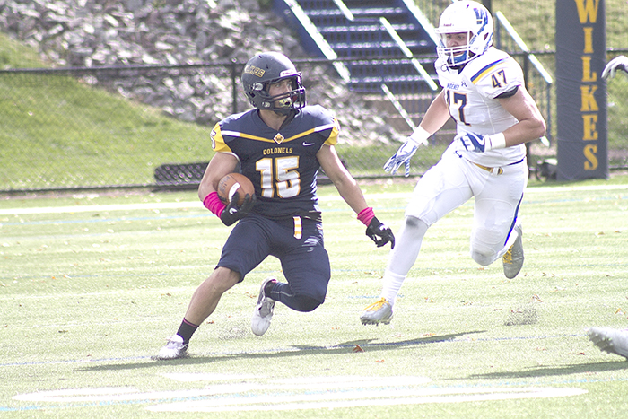 First-year wide receiver Nick Yanik (15) caught a 27-yard pass from Nick Geimer.