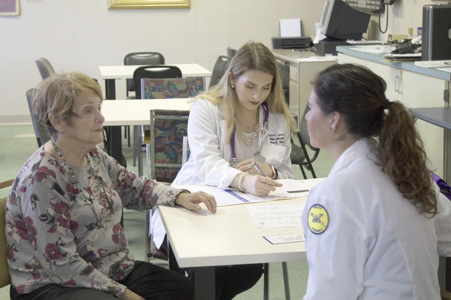 Barbara Greenberg had her medication reviewed by pharmacy students, Rachel Lazevnick and Emily Herron.