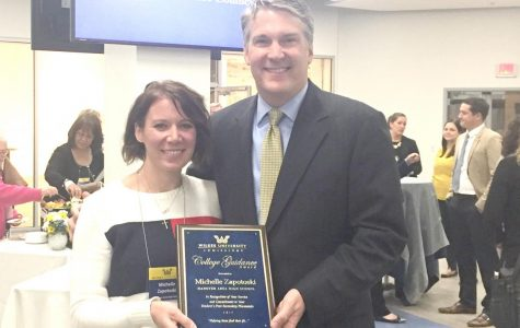 """Michelle Zapotoski, a guidance counselor at Hanover Area Junior Senior High School, poses with Wilkes President Patrick Leahy after being named """"Guidance Counselor of the Year."""