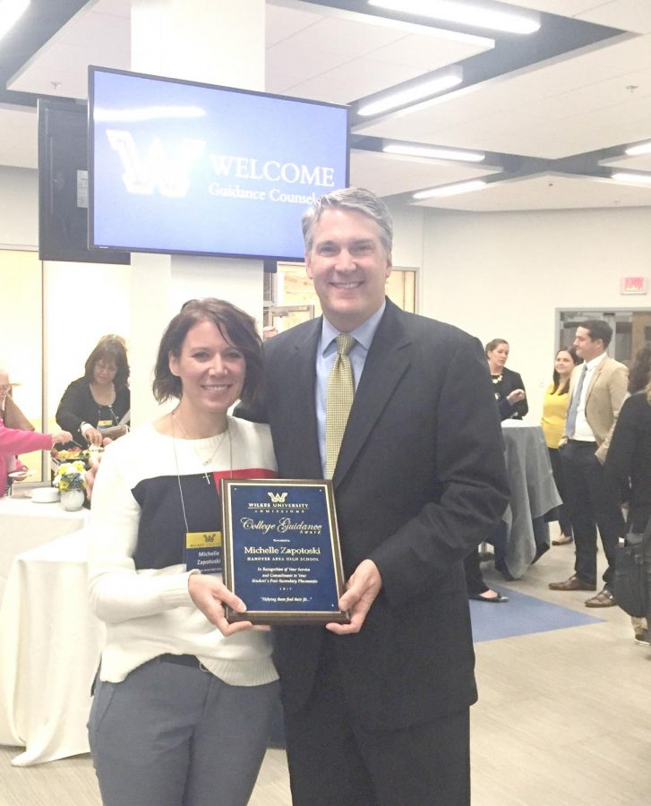 "Michelle Zapotoski, a guidance counselor at Hanover Area Junior Senior High School, poses with Wilkes President Patrick Leahy after being named ""Guidance Counselor of the Year."
