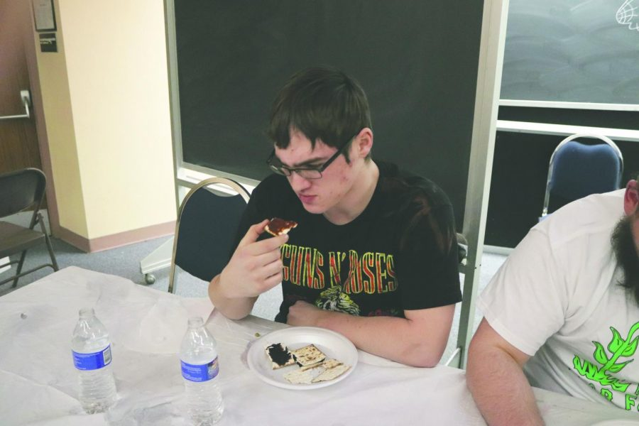 Daulton Moyer observes the vegemite and marmite spreads on his cracker suspiciously.