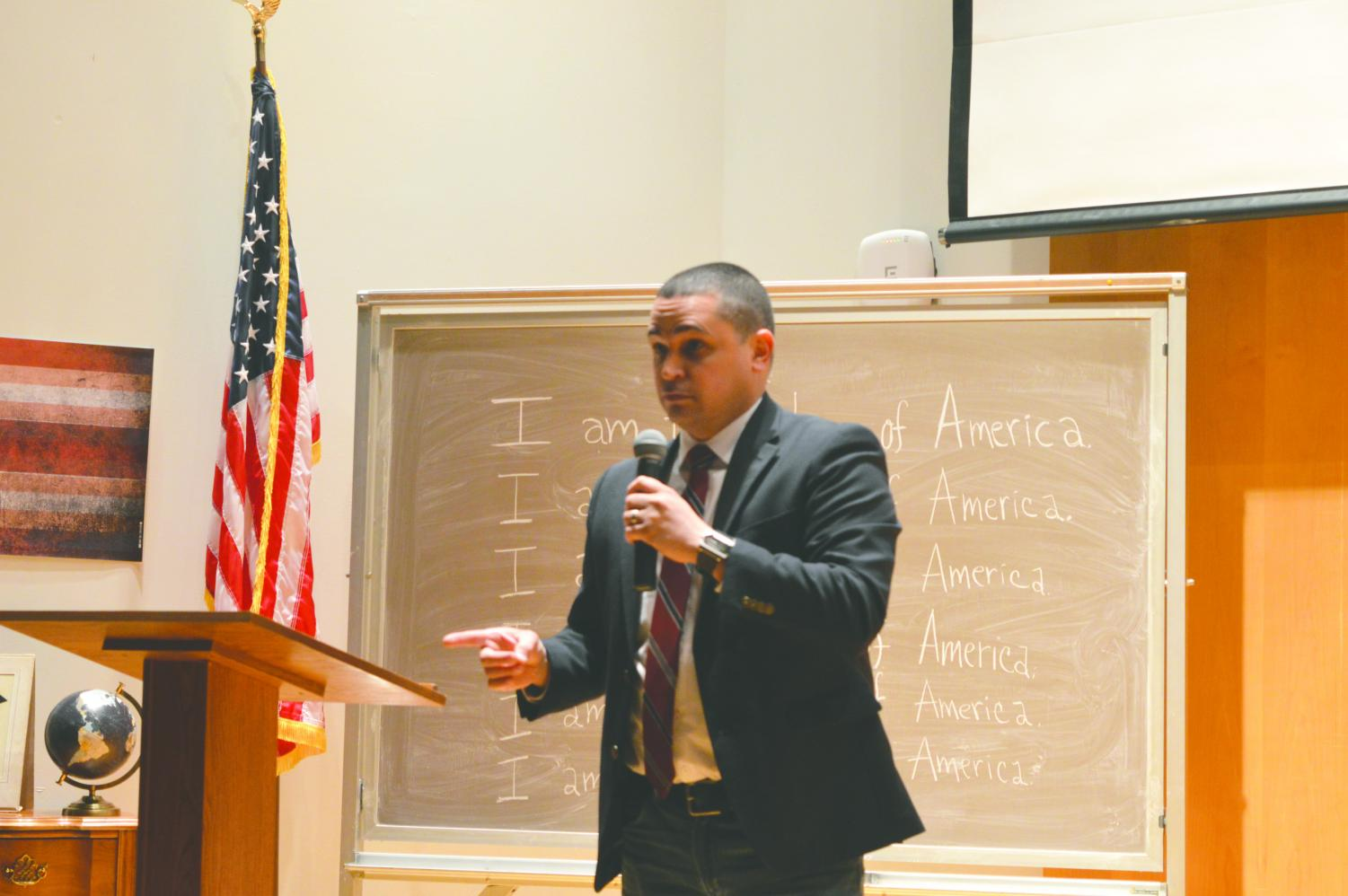 """Dr. Avila spoke in front of a set that featured a chalkboard that said, """"I am the future of America."""" Also on stage were numerous Puerto Rican flags, as well as family photographs."""