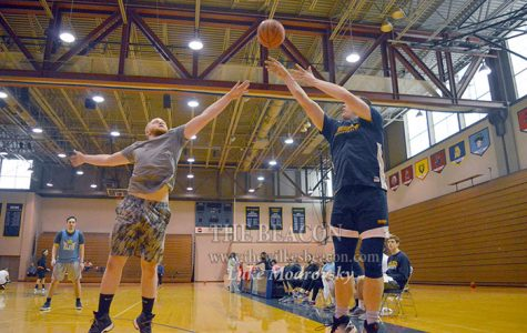 Mason Gross shoots over Angel Lopez during Sunday's 3-on-3 basketball tournament hosted by Wilkes.