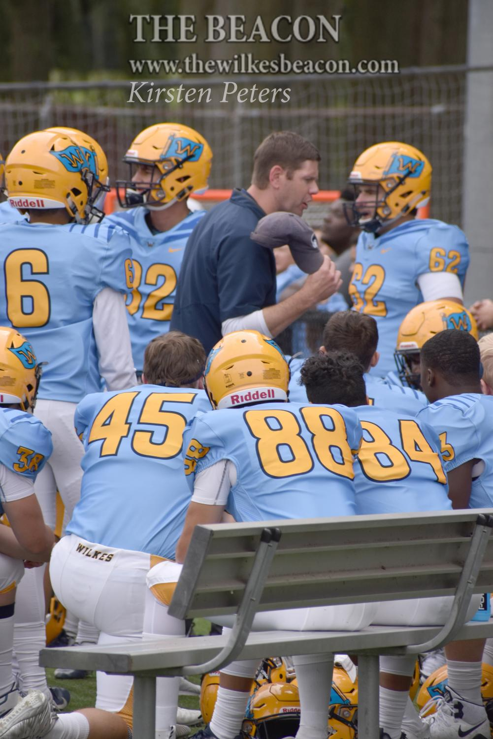Coach Drach gives instruction on the sidelines after not executing a play against Misericordia.