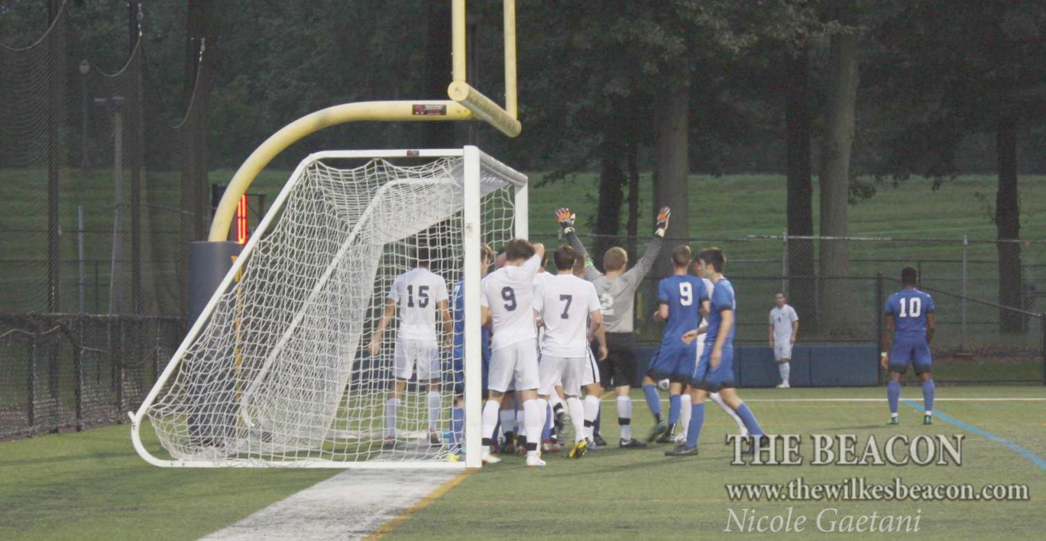 Junior midfielder Ed Lukowski tries to take advantage of a scoring opportunity with a corner kick.