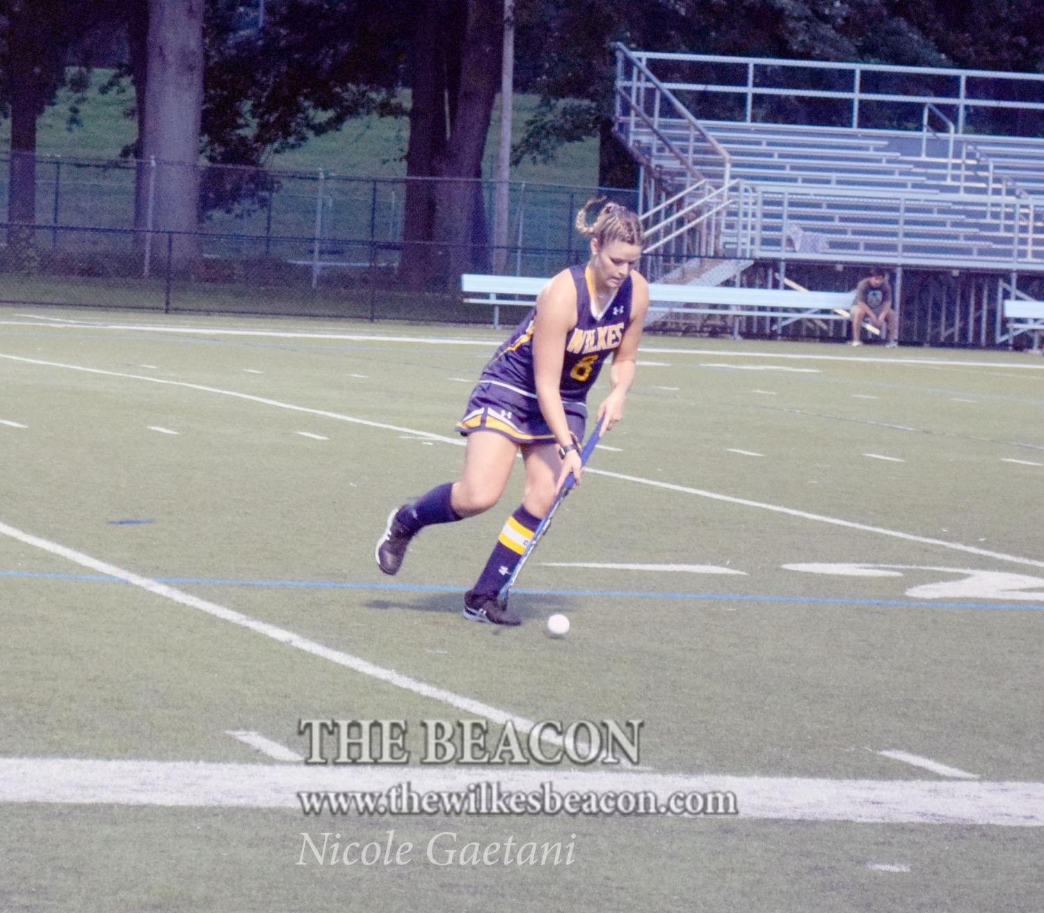 Senior Haley Gayoski scans the field as she looks to kick start the Colonels attack.