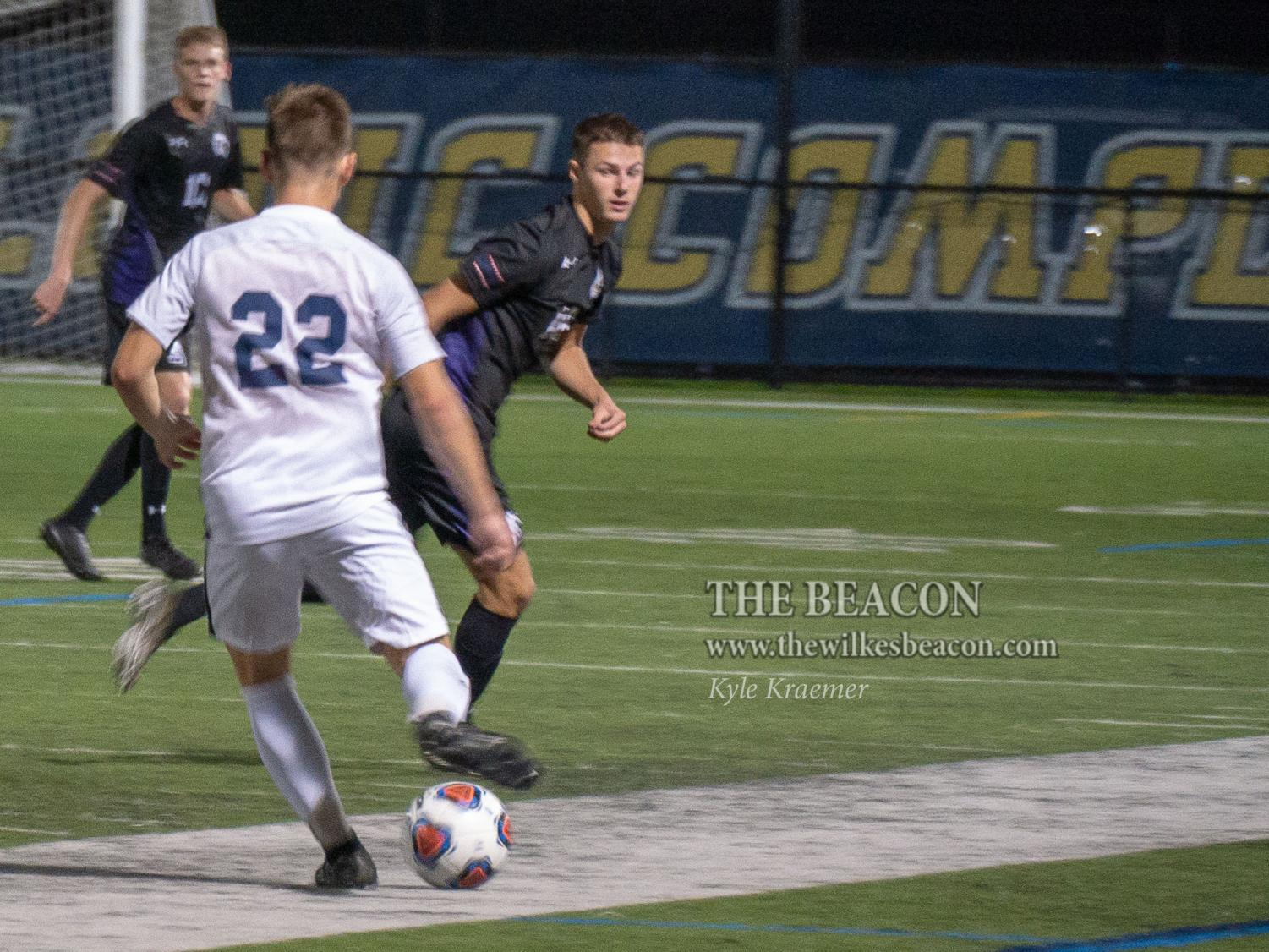 Hunter Maxwell looks to push the ball forward while running the point of the Colonels' attack during a Sept. 26 game against the University of Scranton.