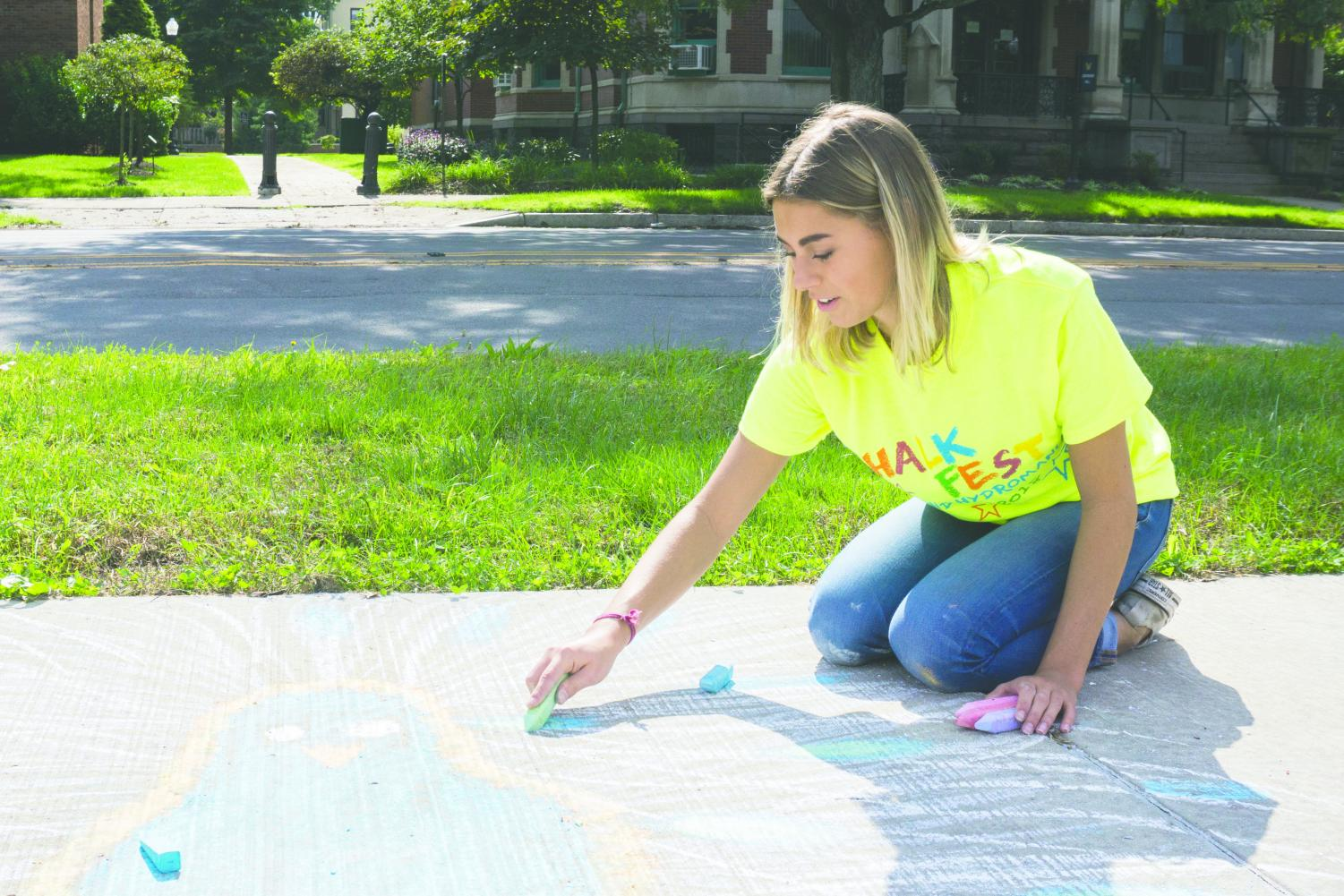 Taylor Hubiak, a sophomore business management major, contributed to the chalk drawing.